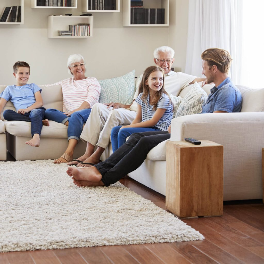 Family gosping in living room | TUF Flooring LLC